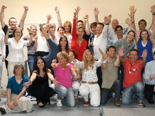 NLP Practitioner Gruppe jubelnd